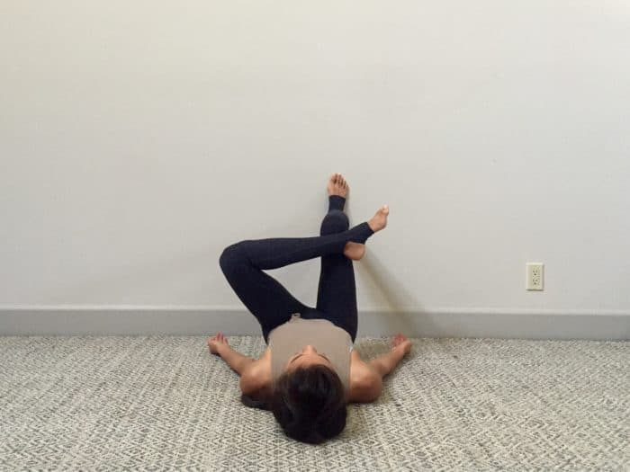 The wall glute stretch